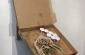 Ossuaries   Shared Space (part a)   2012.  Pizza box, cardboard,  wood, mixed materials.  16 x 32in.